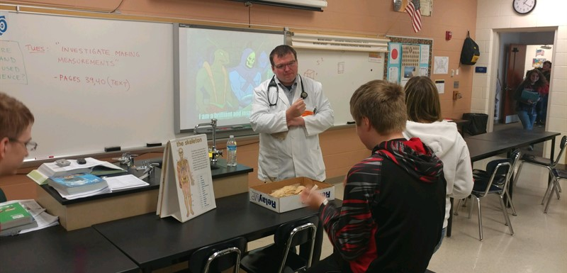 Science class with Med Student Matt leading a lesson.