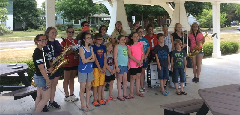 Our band has been busy this summer with band camp, parades, and helping young children learn to love music at the library.