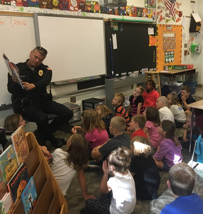 Chief McGee reading to elementary students